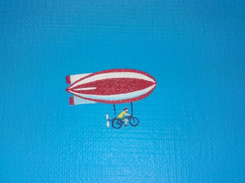 Detail schilderij Follow your dream voorstellende een roodwit gekleurde zeppelin
